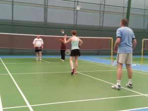 Katie doing a short serve covering the front, whilst Gary takes the back of the court in offensive play